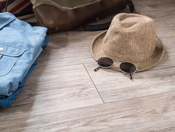Vintage hat , sunglasses and chambray shirt stock photo