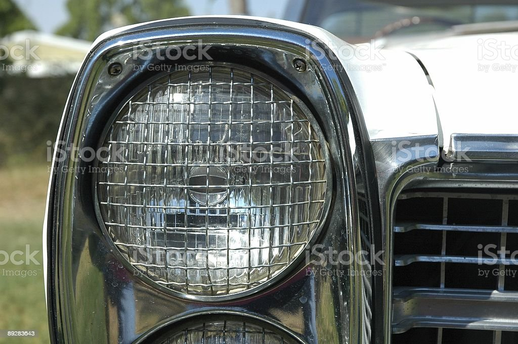 Vintage headlight with grill on a 1070's ford car stock photo