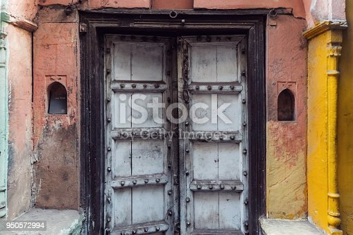Vintage heavy gate of the Hindu temple