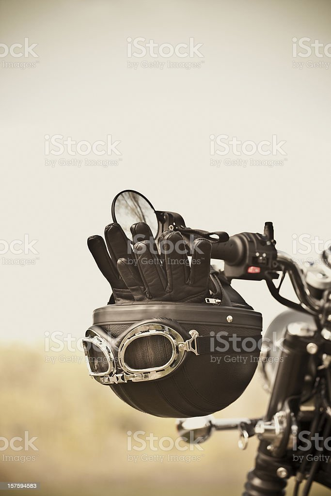 Vintage helmet and gloves on motorcycle stock photo