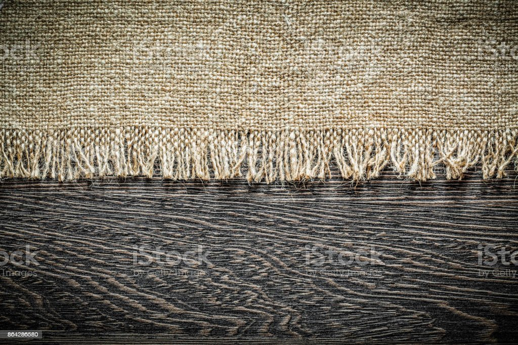 Vintage hessian on wooden board royalty-free stock photo