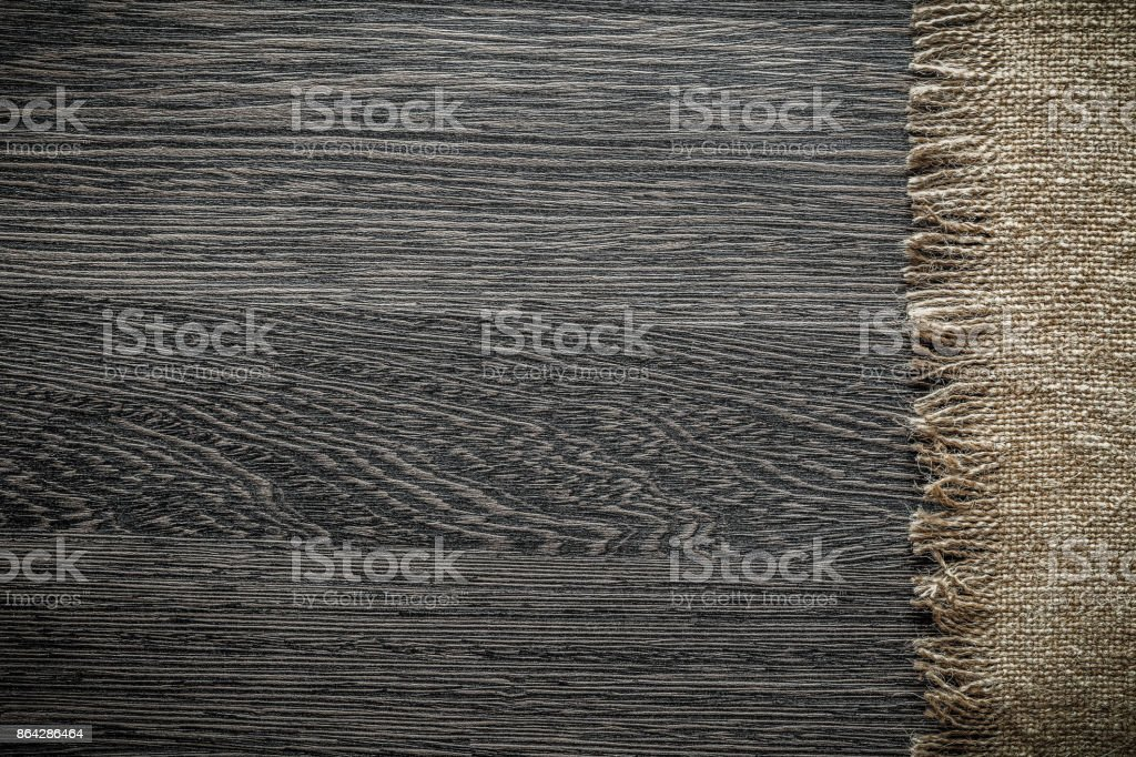 Vintage hessian on wooden board top view royalty-free stock photo