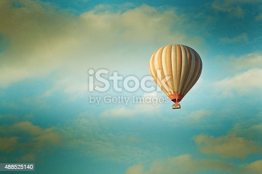 istock vintage hot air balloon in the sky 488525140