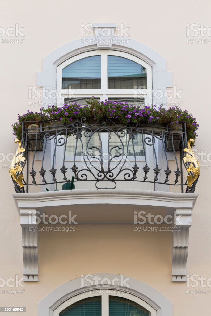 Vintage house balcony with golden ornament stock photo