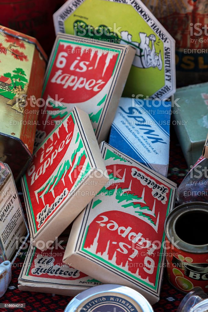 Vintage household articles with advertisements on flea market. stock photo