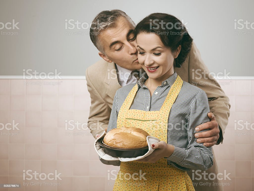 Vintage husband kissing his wife stock photo