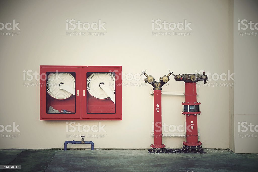 Vintage Hydrant with water hoses and fire extinguish equipment stock photo