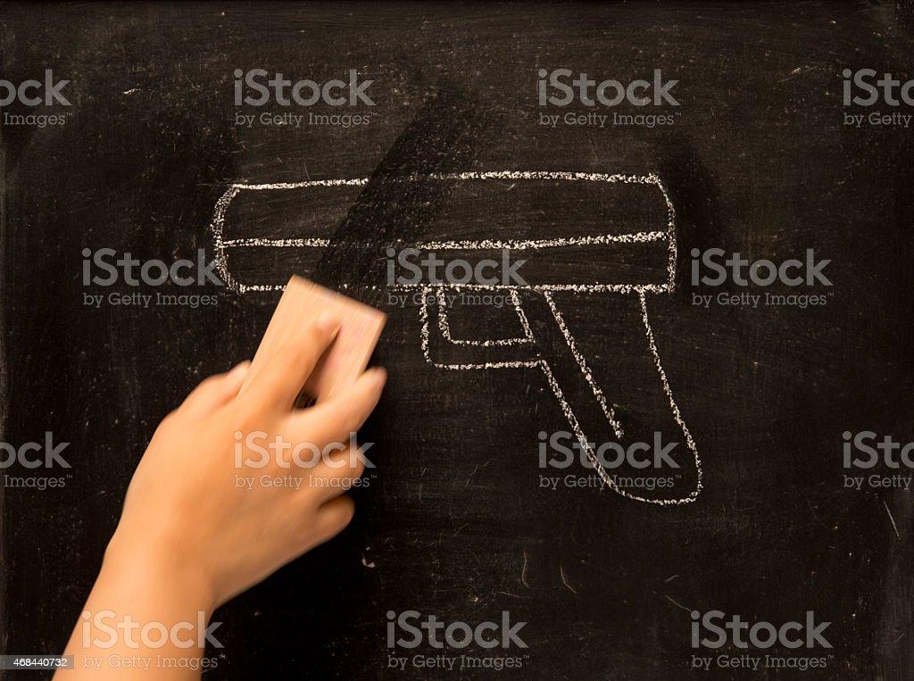 vintage illustration wiping gun on blackboard background stock photo