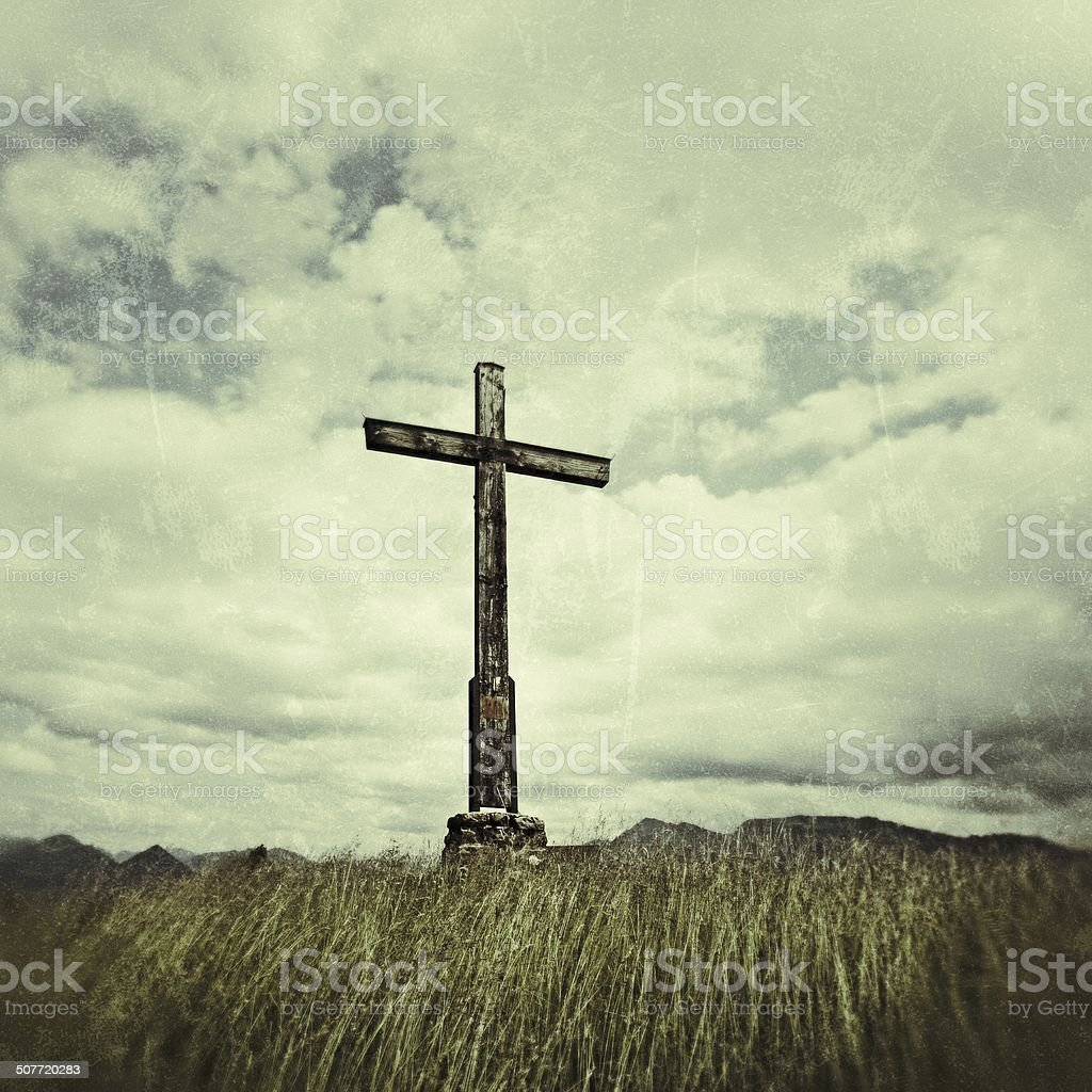 Vintage Image: Cross in front of blue sky with clouds stock photo