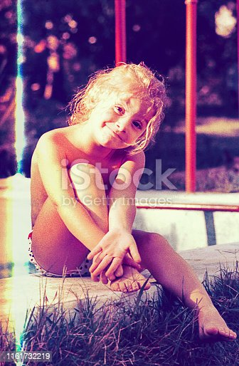 Vintage photo of a cute blonde girl on summer vacations
