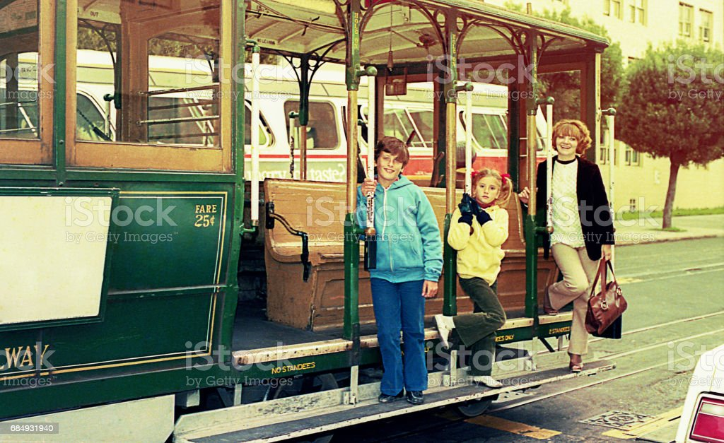 Vintage image of a family in a trolley-car stock photo