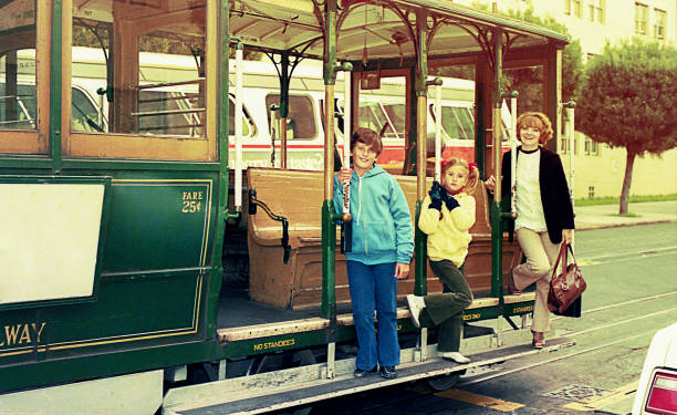 vintage image of a family in a trolley-car - 1980s style stock photos and pictures