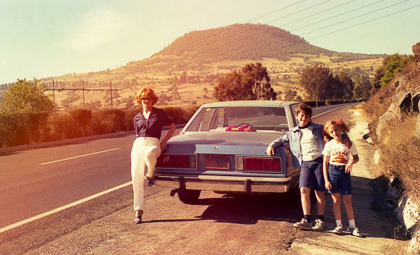 vintage image of a family on the roads - 1980s style stock photos and pictures