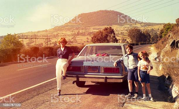 Vintage Image Of A Family On The Roads Stock Photo - Download Image Now