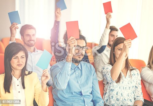 933450738 istock photo Vintage image of people voting in local community 615631388