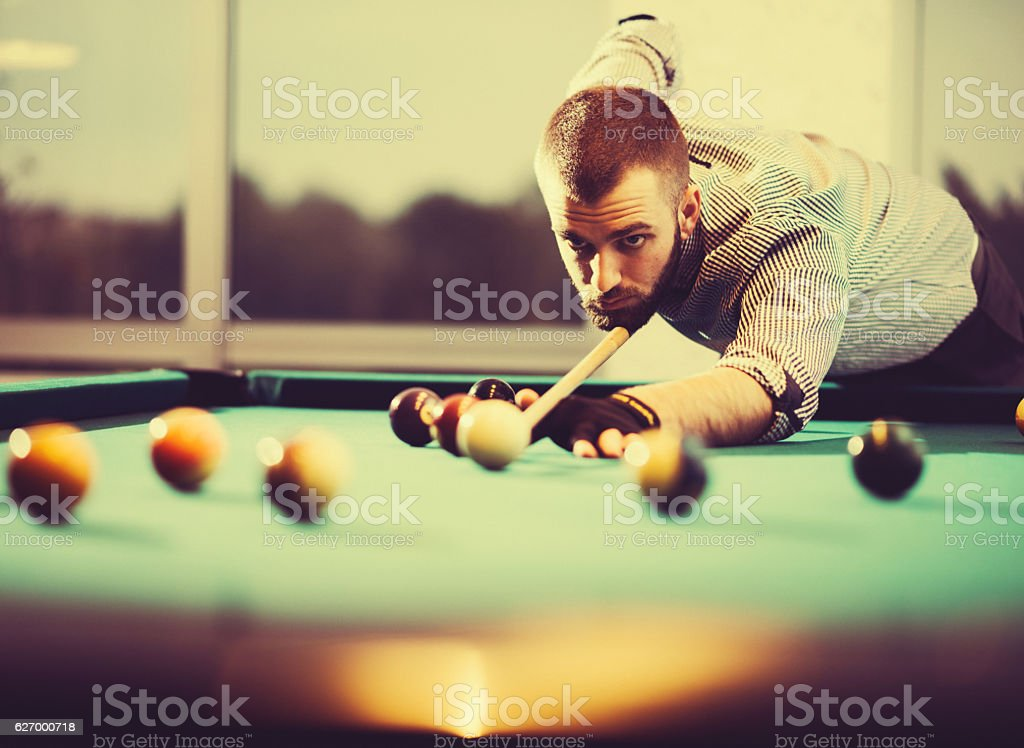 Vintage image of pool player in plaid shirt stock photo