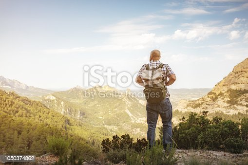 Vintage image of traveler with backpack in mountains
