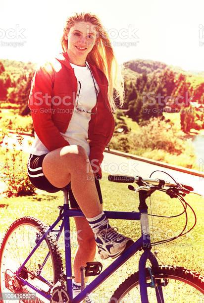 Vintage image of young woman on a bike