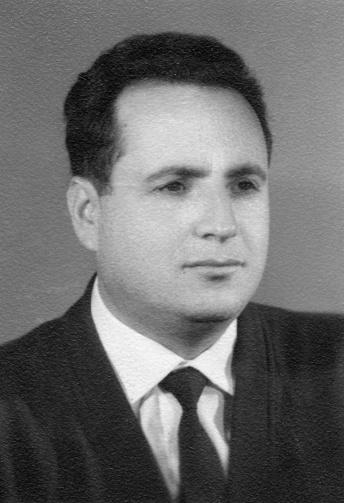 Vintage image portrait, headshot studio photo of a pensive man looking away