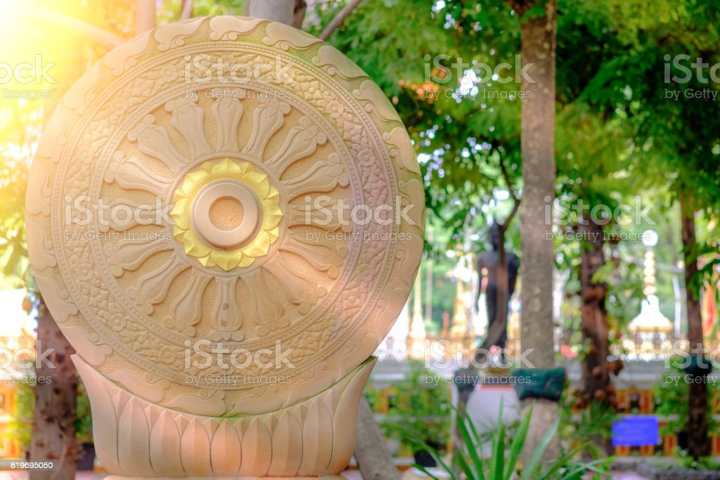Vintage image style, The Wheel of Dharma of temple garden with sunlight  in Bangkok, Thailand stock photo