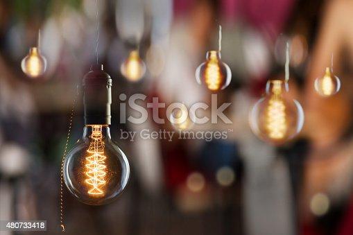 istock Vintage incandescent Edison type bulbs and window reflections 480733418