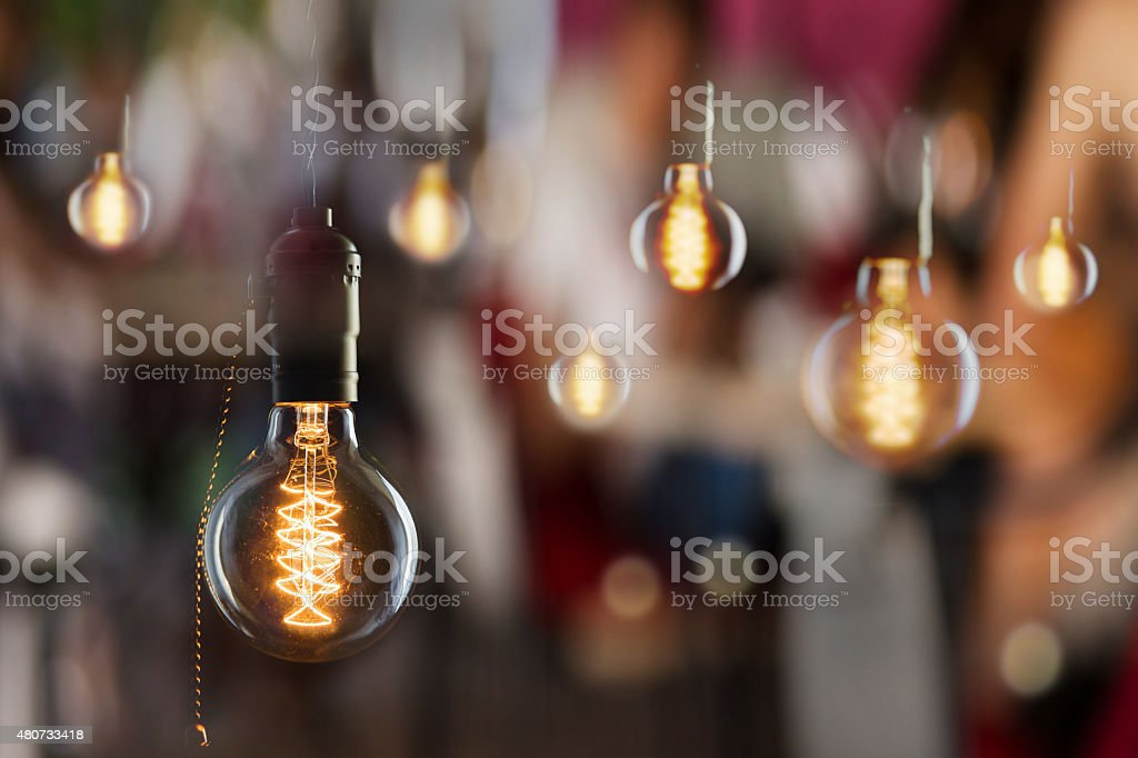 Vintage incandescent Edison type bulbs and window reflections stock photo