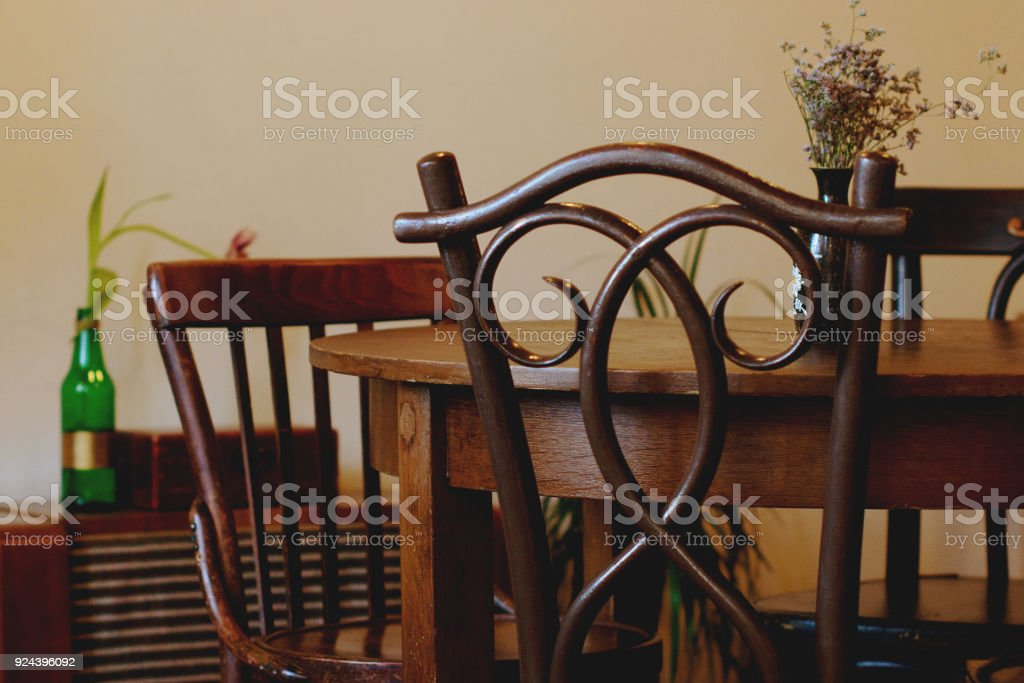 vintage interior backrest chairs table in brown tone stock photo