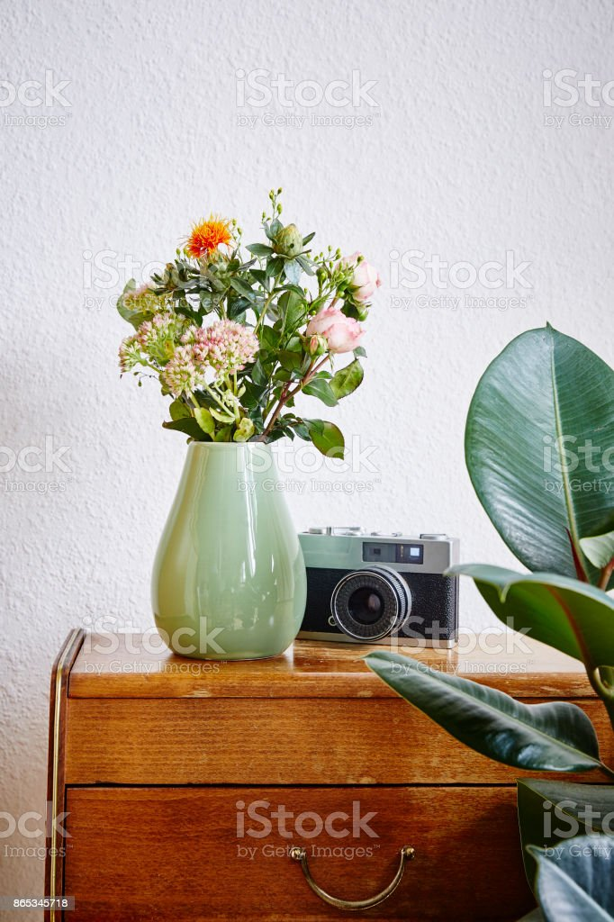 vintage interior design green vase with rose flowers stock photo