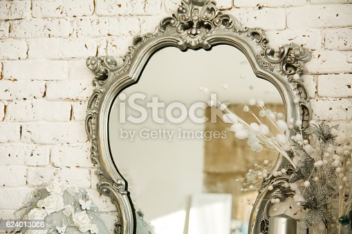 istock Vintage interior with a mirror in beautiful frame 624013086