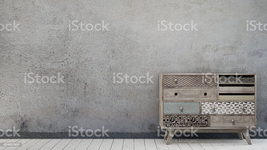 Vintage interior with aged wall and scandinavian chest of drawer stock photo