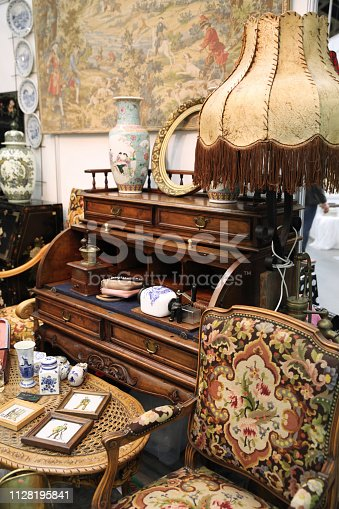 Vintage interior with chair and floor lamp on flea market