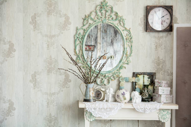 Vintage interior with mirror and a table vase and willows stock photo