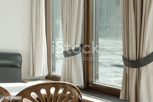 Vintage interiors of a cruise ship - Looking out of the window (Rhine, Germany, Europe)
