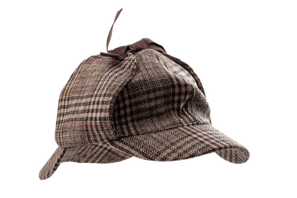 Vintage investigator and retro inspector conceptual idea with deerstalker type hat or Sherlock Holmes cap isolated on white background with clipping path cutout using ghost mannequin technique Vintage investigator and retro inspector conceptual idea with deerstalker type hat or Sherlock Holmes cap isolated on white background with clipping path cutout using ghost mannequin technique sherlock holmes stock pictures, royalty-free photos & images