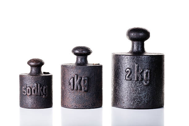 vintage iron weights. - weights stock photos and pictures