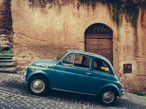 Vintage italian blue car on cobbled street