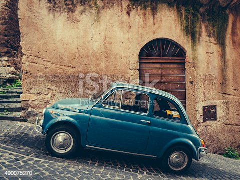 Vintage italian blue car on cobbled street