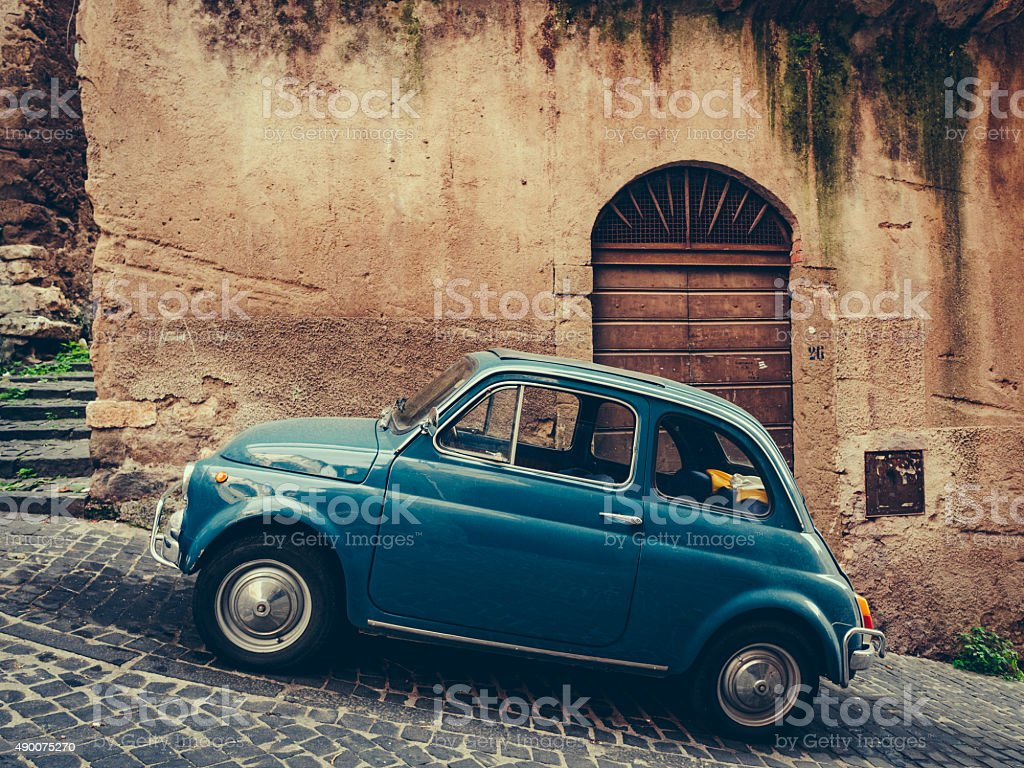 Vintage italian blue car on cobbled street stock photo