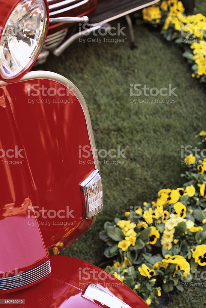 Vintage Italian scooters - copyspace on grass royalty-free stock photo