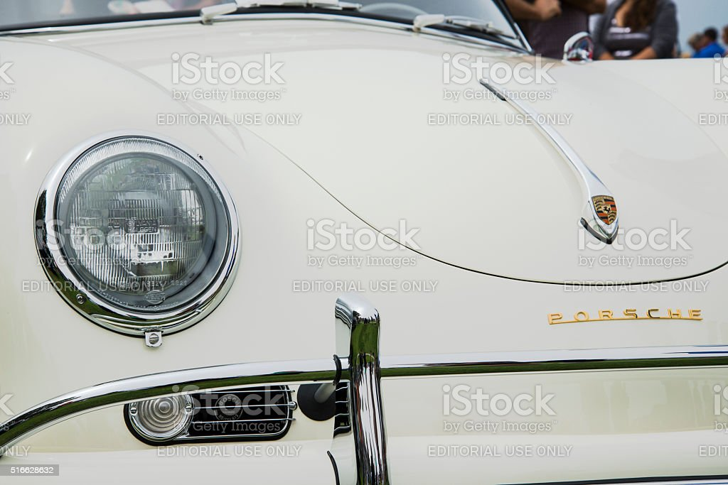 Vintage Ivory Porsche 356A with Bosch Horn Peeking Through Vent Dana Point, CA, USA - July 21, 2013: The front end of a vintage Ivory Porsche 356A, with a peek of the Bosch horn peeking through the right intake vent at the Annual 356 Club of Southern California Dana Point Concours, which took place at Lantern Bay Park. Badge Stock Photo