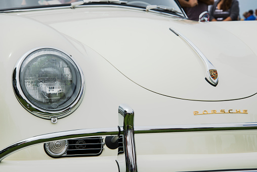 Vintage Ivory Porsche 356a With Bosch Horn Peeking Through Vent Stock Photo - Download Image Now