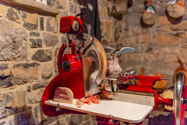 Vintage jamon, prsut or prosciutto slicing machine. Old butcher machinery still in use in Vipava valley, Slovenia