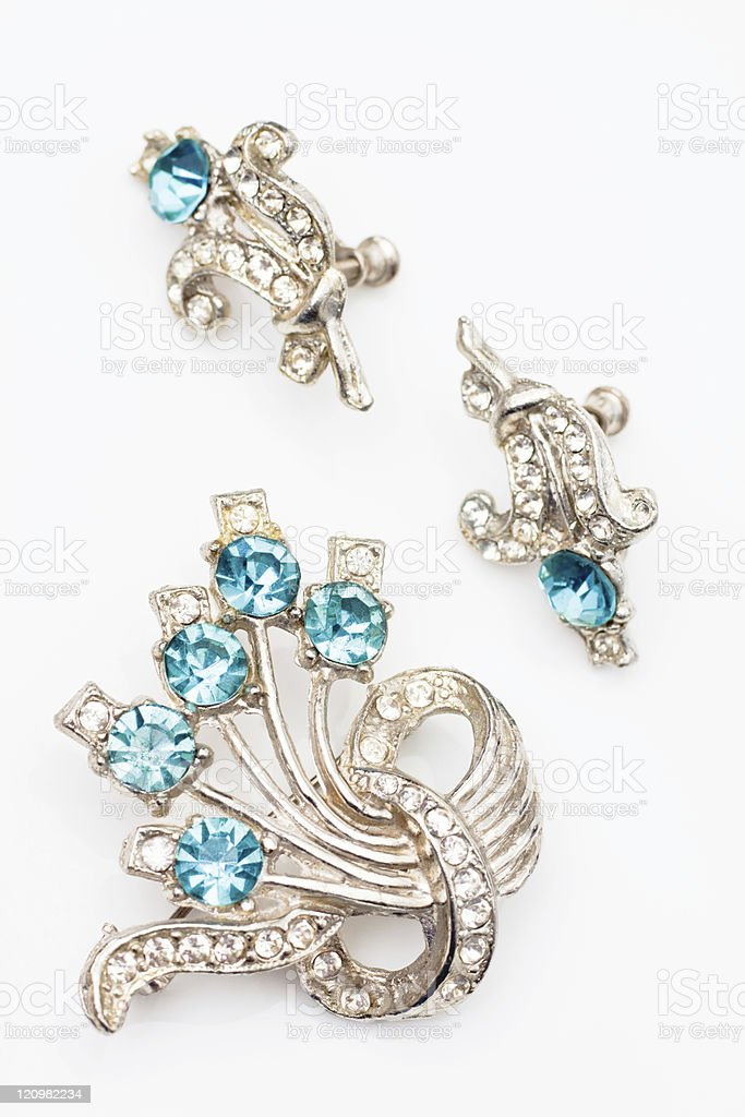 A vintage jewelry set with blue diamonds  stock photo