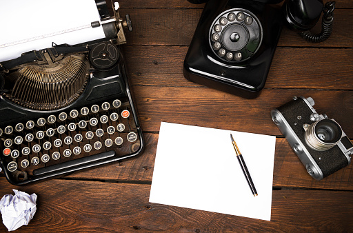 Vintage journalist Desk from Above with empty paper sheet for text