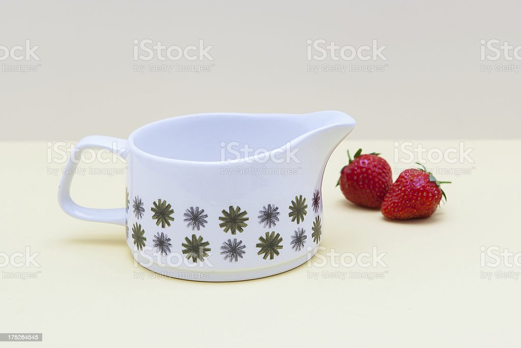 Vintage jug with strawberries stock photo
