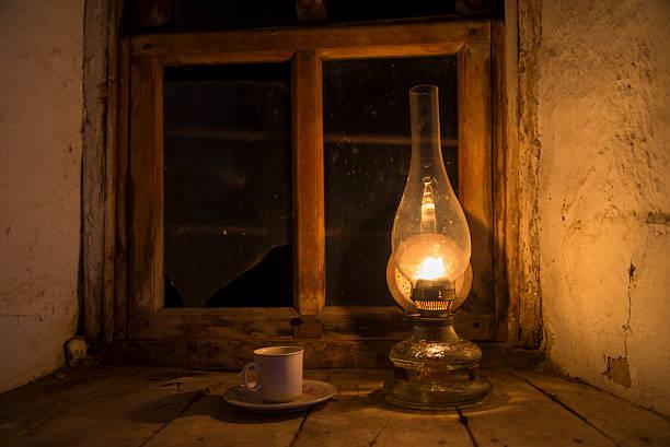 Vintage kerosene lamp at window stock photo