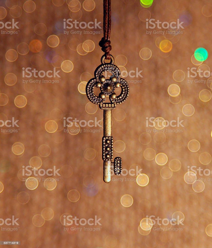 Vintage key on a shiny background foto