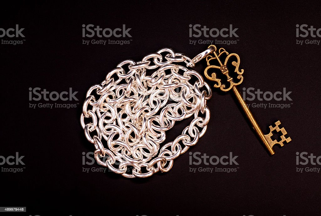Vintage Key  with chain on black background stock photo