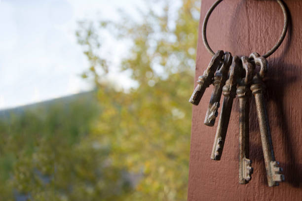 Vintage Keys in the Fall vintage keys hanging from a post in the fall jude beck stock pictures, royalty-free photos & images
