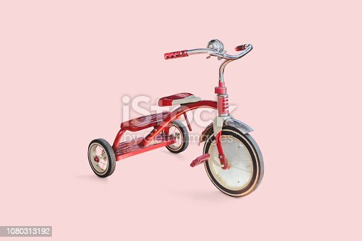 vintage kid red Tricycle on color background.